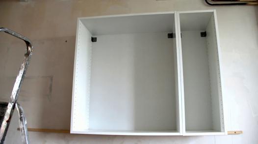 fixer meuble au mur